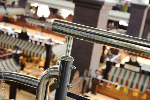 Canvas Metal handrail on blurred market background