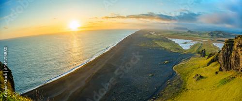 Fotografia Aeria view of Dyrholaey beach Vik village in Iceland