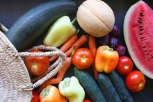 Straw Bag And Various Seasonal Fruit And Vegetable. Flat Lay.
