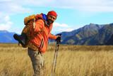 trekking mountains man walking sticks travel adventure man with backpack