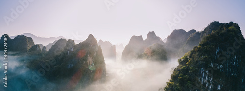 Fotografie, Obraz Aerial panorama view of beautiful sunrise over karst mountain peak landscape