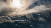 A Dark Thundercloud With A Rainbow