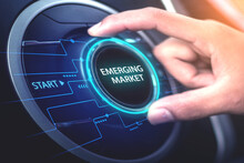 Emerging Market,internet Technology Business Concept And Network A Young Businessman Uses His Hand To Turn A Tone Switch Labeled Emerging Markets.