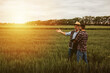 Leinwandbild Motiv farmers talking on wheat field