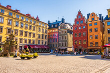 Stockholm Sweden - July 1 2021: Colourful Historic Buildings And Houses In Gamla Stan, Main S. Romantic Medieval City Centre Alleys. Popular Tourist Destination In Scandinavia On A Sunny Day.