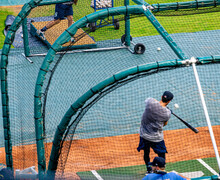 Baseball Player Taking Batting Practice Before The Game