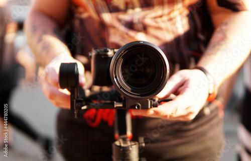 Fotografie, Obraz A man with a camera and a lens