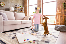 Portrait Of Attractive Preteen Girl Resting With Cute Doggy Feeding Having Fun Spending Free Time At Light Home House Flat Indoors