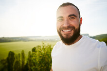 Young Bearded Man Portrait Outdoors In The Mountains
