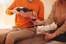 Young Couple Drinking Wine At Home