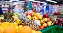 Colorful Fruits On Farmer Market Supermarket. Oranges, Apples And Pineapples Sold At Grocery Shop. Various Healthy Local And Exotic Food