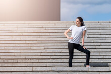 Fitness Girl Jumping On Stairs During Her Morning Workout. Urban Sport Concept