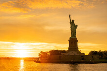 The Statue Of Liberty At New York City During Sunset