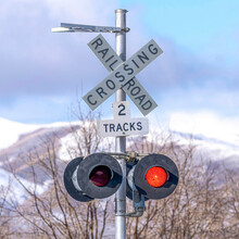 Square Grade Crossing Signal With Red Light Gate And Crossbuck At Railroad Crossing