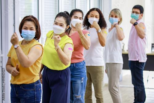Billede på lærred Close up shot of Asian happy strong female patient wears face mask stand look at