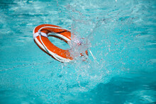 Safety Equipment, Life Buoy Or Rescue Buoy Floating On Sea To Rescue. Help In Water Concept.