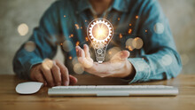 Innovation. Hands Holding Light Bulb For Concept New Idea Concept With Innovation And Inspiration, Innovative Technology In Science And Communication Concept,.