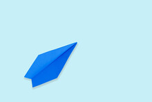 Blue Paper Airplane, On A Blue Background