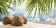 Fresh Coconuts On Sand And Landscape Of Sea