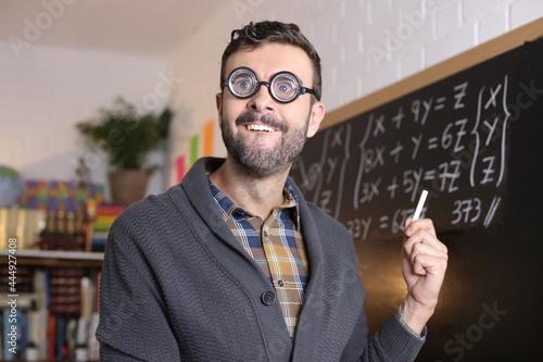 Obraz na plátně Math teacher with thick eyeglasses