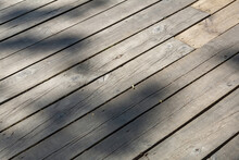 Textured Rough Surface Of Wooden Planks. Walking Path In The Park