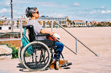 Happy Handicapped Woman On Beach