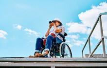 Handicapped Female Traveler Taking Photos On Street