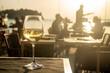 Leinwandbild Motiv evening dining with white glass on table