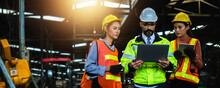 Mechanical Engineer Manager Working In Industry And Factory Control Worker And Introduce Teamwork On Laptop Wearing Safety Reflective Vest And  Helmet, Teamwork And Team Concept