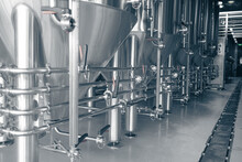 Private Microbrewery. Modern Beer Plant With Brewering Kettles, Tubes And Tanks Made Of Stainless Steel