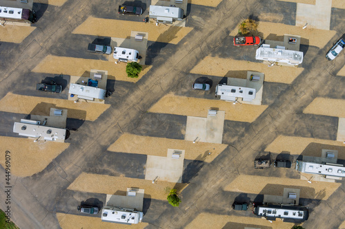 Aerial view of travel RV clubhouse with camping RV trailer on resort parking camping park