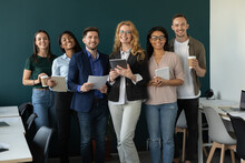 Happy Diverse Business Team, Staff, Employees Of Different Ages, Generations, Races Smiling At Camera. Group Office Portrait Of Mature Female Leader, Teacher With Young Multiethnic Workers