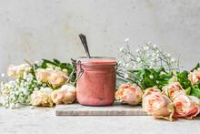 Rhubarb Curd In A Jar With Flowers