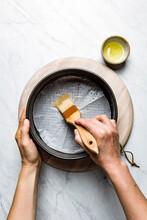 Oiling Of A Cake Tin Prior To Baking