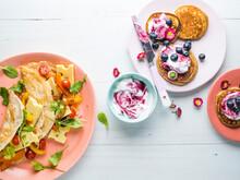 Savoury Crepe And Pancakes On Pink Plates