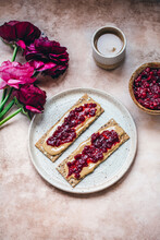 Peanut Butter And Cranberry Jam On Crackers