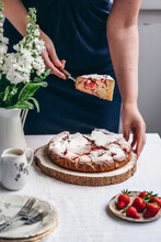 Woman Holding A Slice Of Strawberry Cake