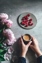 Woman Holding A Cup Of Coffee, With Flowers And Fruit