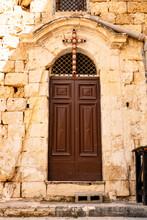 Church Door And Cross
