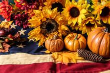 Autumn Orange Pumpkins And Yellow Sunflowers On American Flag