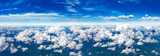 Fototapeta Zwierzęta - sky panorama.Clear blue sky and white clouds, cloud panorama from above, view from the plane.