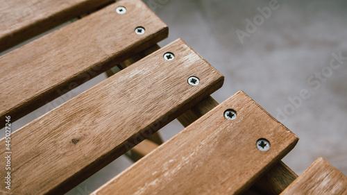 Billede på lærred Wooden deck chair detail