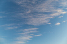 Thin Clouds On Bright Blue Sky.