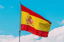 Shot Of A Spanish Flag On Blue Sky Background