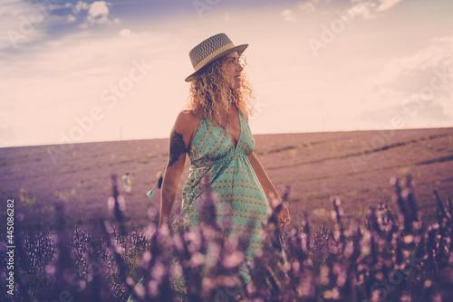 Fototapeta Portrait of beautiful fashion woman in lavender fields visiting valensole proven
