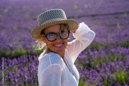 Fotografie, Obraz Portrait of pretty middle age cheerful woman with violet purple lavender field i