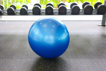 Interior Of Modern Gym With Equipment. Exercise Blue Color Ball In Fitness, Gym Equipment And Fitness Balls In Sports Club.