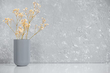 Gypsophila Flowers In A Vase. Soft Light, Minimalism, Grey Walls, White Table. Empty Space For Text. Spring Still Life.