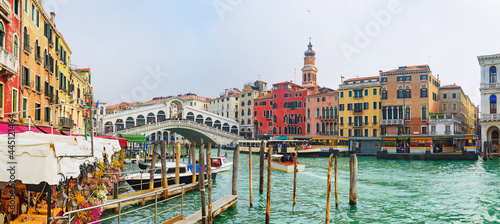View of the Rialto Bridge of the Grand Canal on a sunny day in Venice, Italy