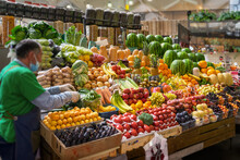 Assortment Of Fresh Organic Vegetables And Fruits At The Farmers Market, Abstract Salesman, Farmer. Autumn Harvest
